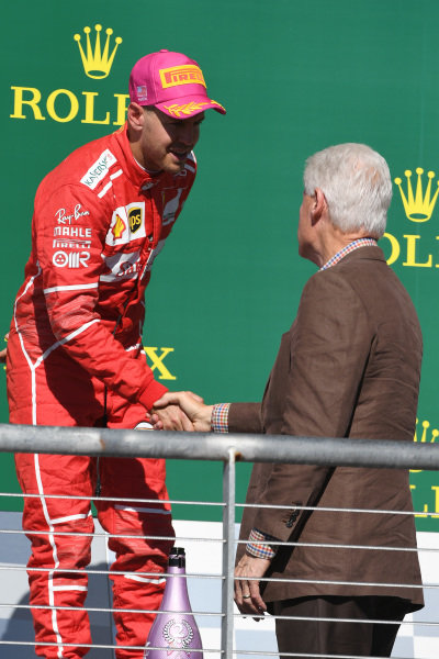 Sebastian Vettel (GER) Ferrari on the podium with Bill Clinton (USA) at Formula One World Championship, Rd17, United States Grand Prix, Race, Circuit of the Americas, Austin, Texas, USA, Sunday 22 October 2017.