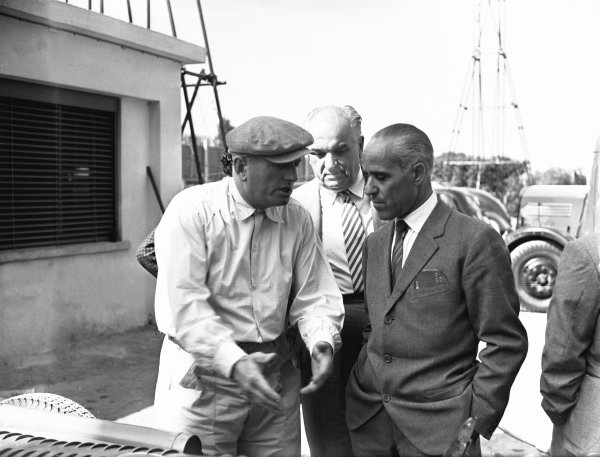 1949 Italian Grand Prix.Monza, Italy. 11 September 1949.Philippe Etancelin and Tazio Nuvolari talk in the paddock.Ref-C25314.World Copyright: LAT Photographic