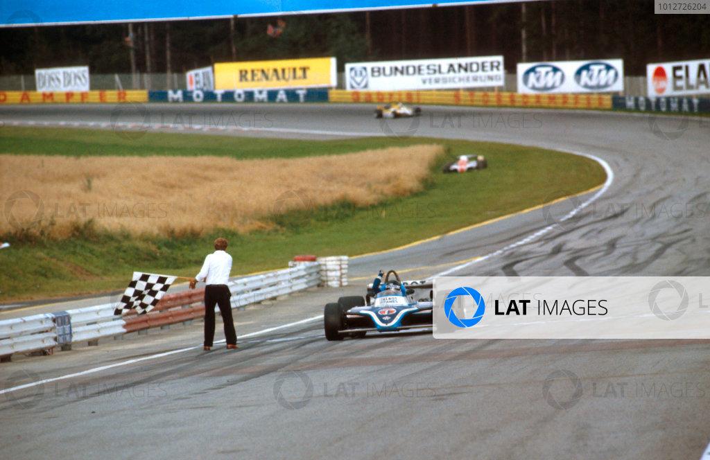 1981 Austrian Grand Prix.Osterreichring, Zeltweg, Austria.14-16 August 1981.Jacques Laffite (Talbot Ligier JS17 Matra) takes the chequered flag for 1st position.Ref-81 AUT 08.World Copyright - LAT Photographic