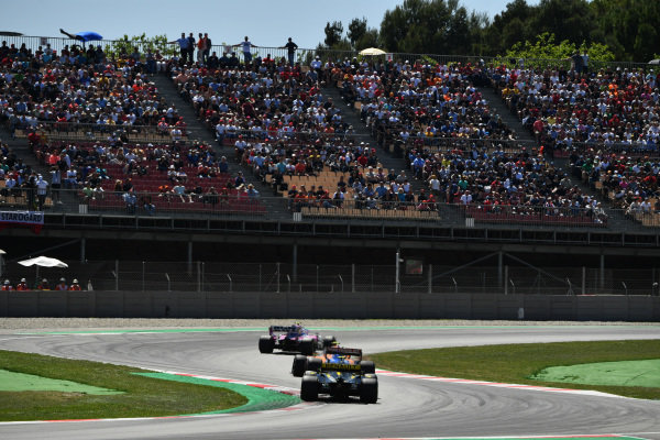 Lance Stroll, Racing Point RP19, leads Lando Norris, McLaren MCL34, and Nico Hulkenberg, Renault R.S. 19