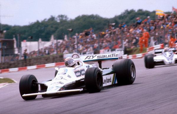 1980 British Grand Prix.Brands Hatch, England.11-13 July 1980.Alan Jones (Williams FW07B Ford) 1st position at Paddock Hill Bend.Ref-80 GB 01.World Copyright - LAT Photographic