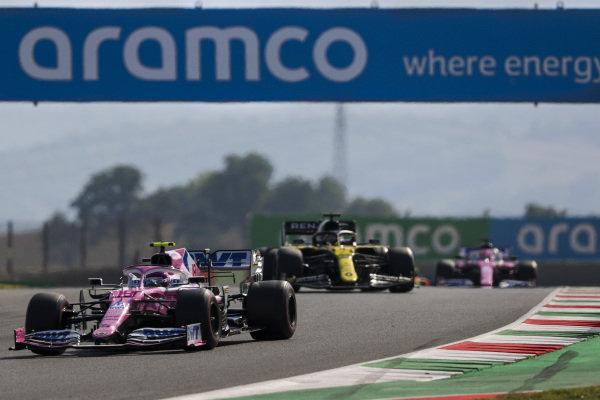Lance Stroll, Racing Point RP20, leads Daniel Ricciardo, Renault R.S.20, and Sergio Perez, Racing Point RP20