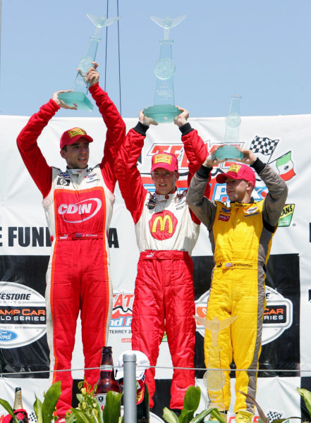 The podium: Justin Wilson (GBR) RuSPORT 2nd, Sebastien Bourdais (FRA) 1st and A.J Allmendinger (USA) 3rd.