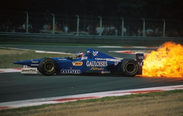 Jarno Trulli (ITA) Ligier spins due to a huge oil fire Formula One World Championship, Italian Grand Prix, Rd13, Monza, Italy, 7 September 1997.