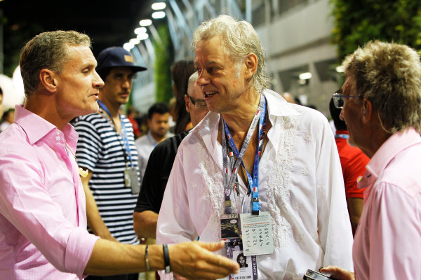 Marina Bay Circuit, Singapore. Saturday 21st September 2013.  Bob Geldof talks to David Coulthard in the paddock.  World Copyright: Jed Leicester/LAT Photographic. ref: Digital Image _JED2619