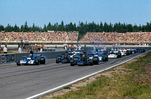 1973 Swedish Grand Prix.  Anderstorp, Sweden. 15-17th June 1973.  Ronnie Peterson, Lotus 72E Ford, and François Cevert, Tyrrell 006 Ford, lead off the front row from Emerson Fittipaldi, Lotus 72E Ford, and Jackie Stewart, Tyrrell 006 Ford, at the start.  Ref: 73SWE03. World Copyright: LAT Photographic