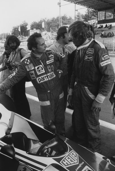 Zolder, Belgium. 14th - 16th May 1976. James Hunt (McLaren M23-Ford), in conversation with Niki Lauda (Ferrari 312T2), portrait.  World Copyright: LAT Photographic. Ref: L76 - 741 - 18.