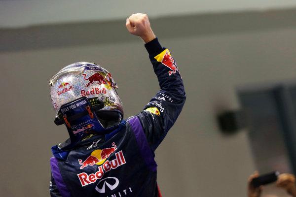 Marina Bay Circuit, Singapore. Sunday 22nd September 2013.  Sebastian Vettel, Red Bull Racing, celebrates in parc ferme.  World Copyright: Charles Coates/LAT Photographic. ref: Digital Image _N7T7780