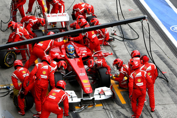 Nurburgring, Germany.24th July 2011Fernando Alonso, Ferrari 150° Italia, 2nd position, makes a stop. Action. Pit Stops. World Copyright: Andy Hone/LAT Photographicref: Digital Image CSP23884