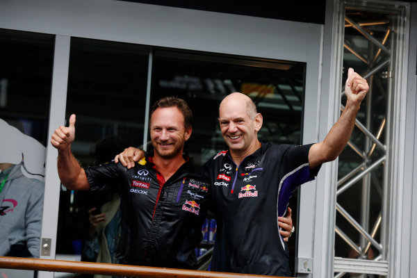 Spa-Francorchamps, Spa, Belgium. Saturday 23 August 2014. Christian Horner, Team Principal, Red Bull Racing, and Adrian Newey, Chief Technical Officer, Red Bull Racing, after doing the Ice Bucket Challenge. World Copyright: Charles Coates/LAT Photographic. ref: Digital Image _J5R1164