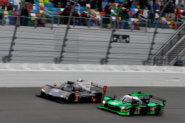 2017 Rolex 24 Hours. Daytona, Florida, USA Saturday 28 January 2017. #70 Mazda Motorsports Mazda DPi: Joel Miller, Tom Long, James Hinchcliffe; #2 Tequila Patr?n ESM Nissan DPi: Scott Sharp, Ryan Dalziel, Luis Felipe Derani, Brendon Hartley World Copyright: Alexander Trienitz/LAT Images ref: Digital Image 2017-24h-Daytona-AT2-2369