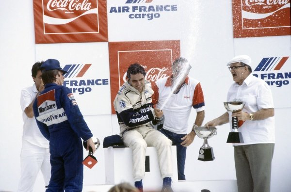1982 Brazilian Grand Prix.Rio de Janeiro, Brazil. 19-21 March 1982.Nelson Piquet (Brabham BT49D-Ford Cosworth) celebrates on the podium with Keke Rosberg (left, Williams FW07C-Ford Cosworth). Piquet had collapsed with heat exhaustion. He and Rosberg were subsequently disqualified for having underweight cars.World Copyright: LAT PhotographicRef: 35mm transparency 82BRA36