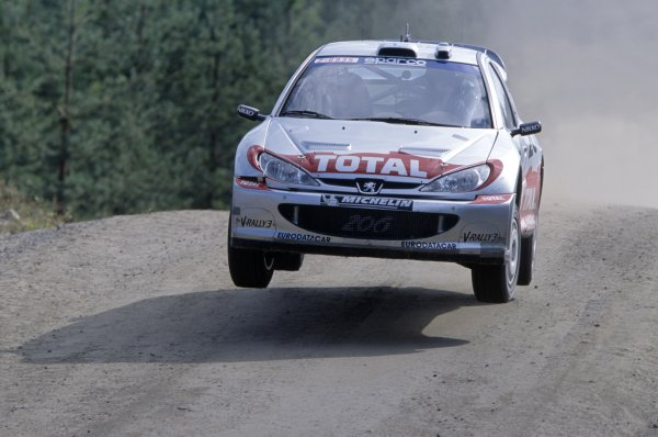 2002 World Rally Championship.Finnish Rally, Finland. 8-11 August 2002.Marcus Gronholm/Timo Rautiainen (Peugeot 206 WRC), 1st position.World Copyright: McKlein/LAT PhotographicRef: 35mm transparency 02RALLY09