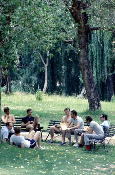 The GPDA (Grand Prix Drivers Association) hold their annual meeting under the trees (L to R):  Jochen Rindt (AUT), Denny Hulme (NZL), Dan Gurney (USA), Chris Amon (NZL), Graham Hill (GBR), Jo Bonnier (SUI), Piers Courage (GBR) and Pedro Rodriguez (MEX).