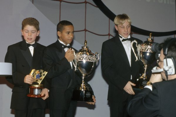1997 Autosport Awards.Grosvenor House Hotel, Park Lane, London, Great Britain. 7 December 1997.Paul di Resta, Lewis Hamilton and Stefan Hodgetts with their karting trophies, portrait.World Copyright: Bloxham/LAT PhotographicRef: 35mm transparency