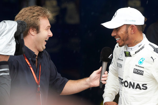 Autodromo Nazionale di Monza, Italy. Saturday 2 September 2017. Lewis Hamilton, Mercedes AMG, is interviewed by Davide Velsecci after securing his record breaking 69th F1 career pole position. World Copyright: Steve Etherington/LAT Images  ref: Digital Image SNE15080