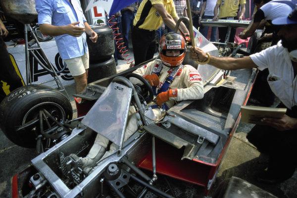 Gilles Villeneuve, Ferrari 312T4, in the pits during practice.