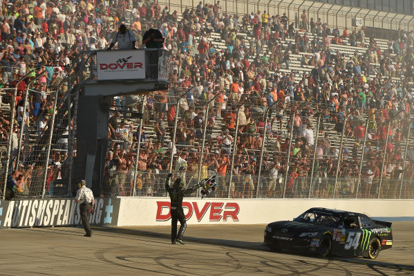 25-27 September, 2014, Dover, Delaware USA Kyle Busch, Monster Energy Toyota Camry celebrates the win with the checkered flag ?2014, Scott R LePage  LAT Photo USA
