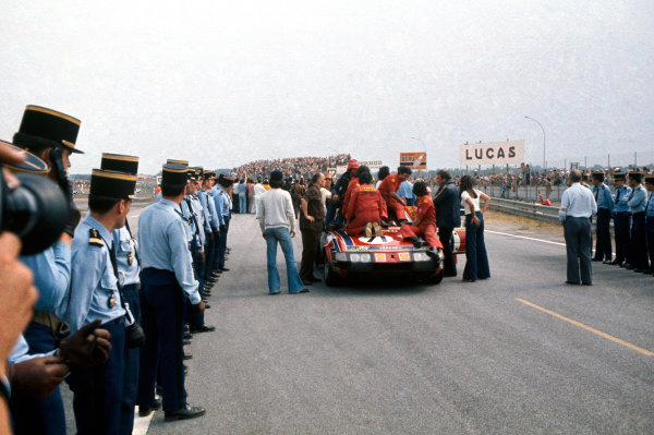 Le Mans, France. 15-16 June 1974.Cyril Grandet/Dominique 'Bardini' (Ferrari 365 GTB/4), 5th position, is greeted by the mechanics after winning it's Class, action. World Copyright: LAT PhotographicRef: 74LM