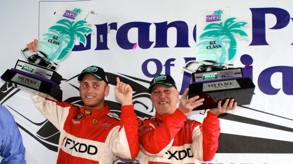 27-29 March, 2012, Homestead, Florida USA GT class winners Jeff Segal, left, and Emil Assentato hold their trophies. (c)2012, R.D. Ethan LAT Photo USA