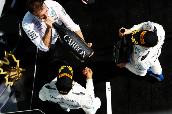 Circuit Gilles Villeneuve, Montreal, Canada. Sunday 11 June 2017. Lewis Hamilton, Mercedes AMG, celebrates victory on the podium with Valtteri Bottas, Mercedes AMG.  World Copyright: Steven Tee/LAT Images ref: Digital Image _O3I0179