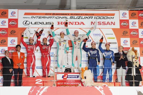 2015 Japanese Super GT Series.  Suzuka, Japan. 30th August 2015. Rd 5. GT500 Winner Daisuke Ito & James Rossiter ( #36 PETRONAS TOM'S RC F ) 2nd position Yuji Tachikawa & Hiroaki Ishiura ( #38 ZENT CERUMO RC F ) 3rd position Hironobu Yasuda & J.P.L.De Oliveira ( #12 CALSONIC IMPUL GT-R ) podium portrait World Copyright: Yasushi Ishihara/LAT Photographic. ref: Digital Image 2015SGT_Rd5_010