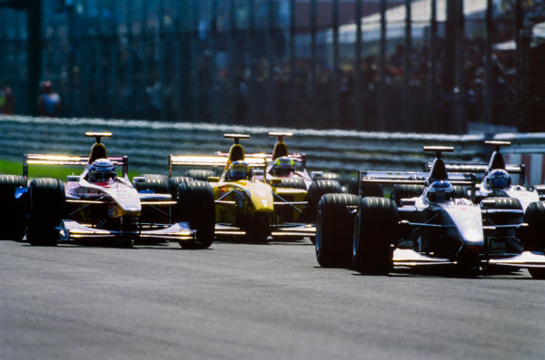 1999 Italian Grand Prix. Monza, Italy. 10th - 12th September 1999. Mika Hakkinen (McLaren MP4/14-Mercedes), retired, leads at the start, action.  World Copyright: LAT Photographic.  Ref:  99ITA