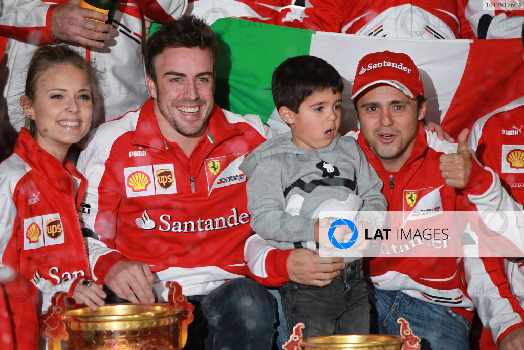 Shanghai International Circuit, Shanghai, China Sunday 14th April 2013 Fernando Alonso, Ferrari, 1st position, celebrates with girlfriend Dasha Kapustina, team mate Felipe Massa, Ferrari, his son Felipinho and the Ferrari team. World Copyright: Andy Hone/LAT Photographic ref: Digital Image HONY7196