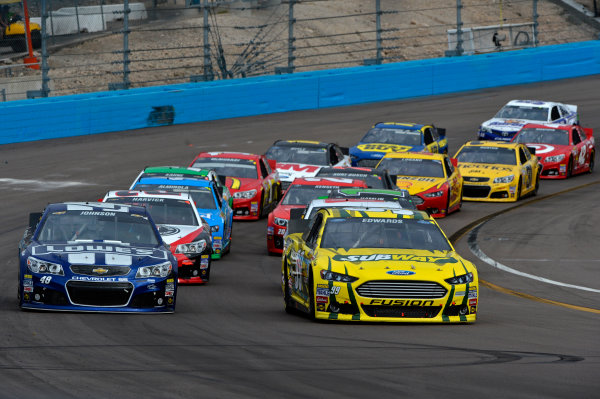 March 1-3, 2013 Avondale, Arizona USA Carl Edwards and Jimmie Johnson restart.(c) 2013, Brian Czobat LAT Photo USA .
