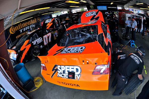 6-8 August, 2010, Watkins Glen, New York,  USAP J. Jones and Robby Gordon cars in garage. © 2010, LAT South, USALAT Photographic