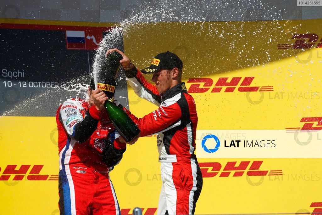 2014 GP3 Series. Round 8.   Sochi Autodrom, Sochi, Russia. Sunday Race 2 Sunday 12 October 2014. Patric Niederhauser (SUI, Arden International) and Marvin Kirchhofer (GER, ART Grand Prix) spray the champagne on the podium. Photo: Sam Bloxham/GP3 Series Media Service. ref: Digital Image _G7C7722