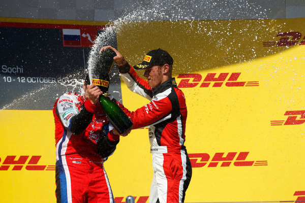 2014 GP3 Series. Round 8.   Sochi Autodrom, Sochi, Russia. Sunday Race 2 Sunday 12 October 2014. Patric Niederhauser (SUI, Arden International) and Marvin Kirchhofer (GER, ART Grand Prix) spray the champagne on the podium. Photo: Sam Bloxham/GP3 Series Media Service. ref: Digital Image _G7C7722