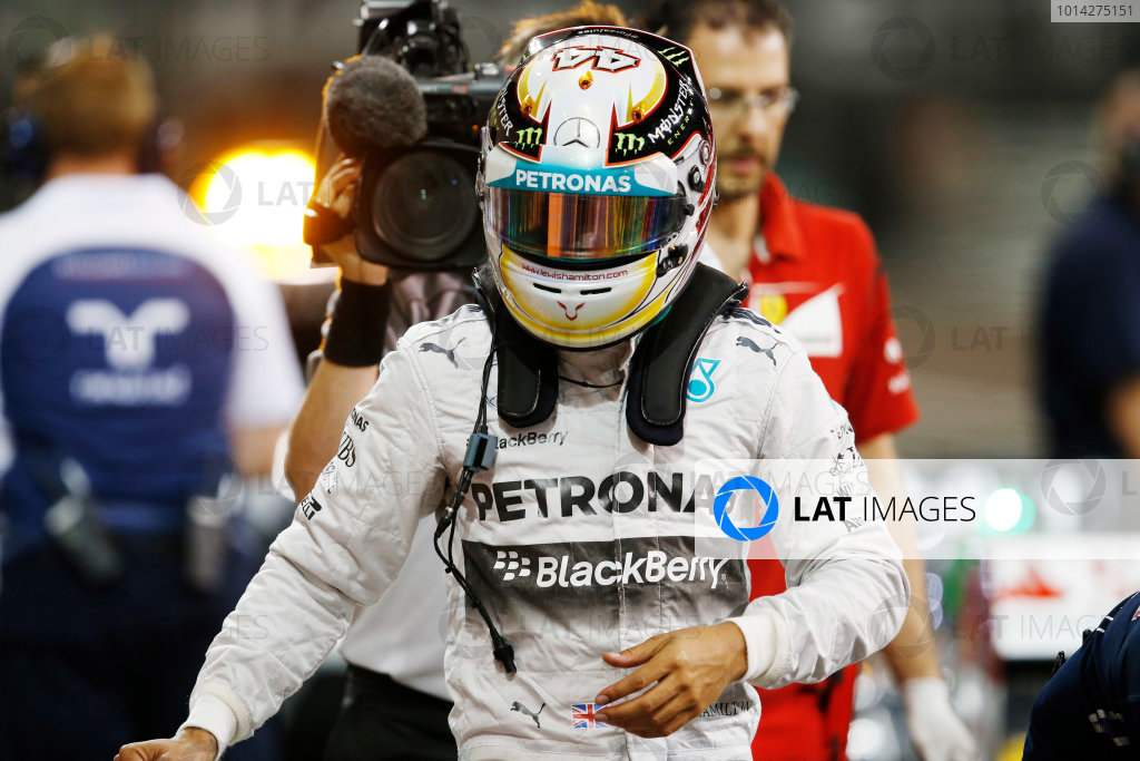 Yas Marina Circuit, Abu Dhabi, United Arab Emirates. Saturday 22 November 2014. Lewis Hamilton, Mercedes AMG, arrives in Parc Ferme after Qualifying. World Copyright: Steven Tee/LAT Photographic. ref: Digital Image _X0W0071