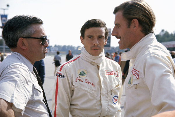 Lotus drivers Jim Clark and Graham Hill with Walter Hayes, public relations executive for Ford.