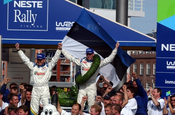 Rally winner Markko Martin (EST), right, and Michael Park (GBR), Ford, celebrate their win on the podium in front of a huge Estonian crowd.FIA World Rally Championship, Rd9, Neste Rally Finland, Jyvaskyla, Finland, Day 3, 10 August 2003.DIGITAL IMAGE