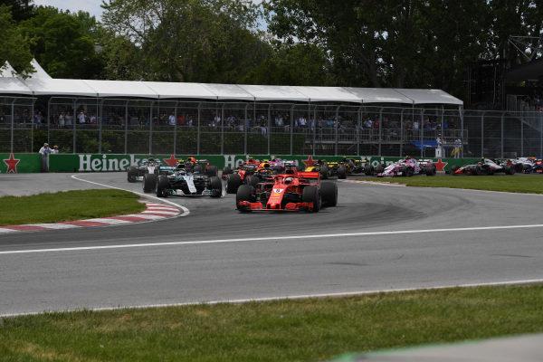 Sebastian Vettel (GER) Ferrari SF-71H leads on lap one .