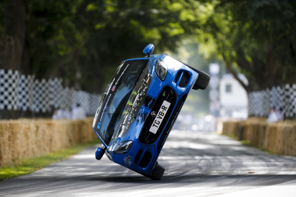 Terry Grant, Stunt Driver drives up the hill in a Jaguar F-Type R Coupe on 2 wheels