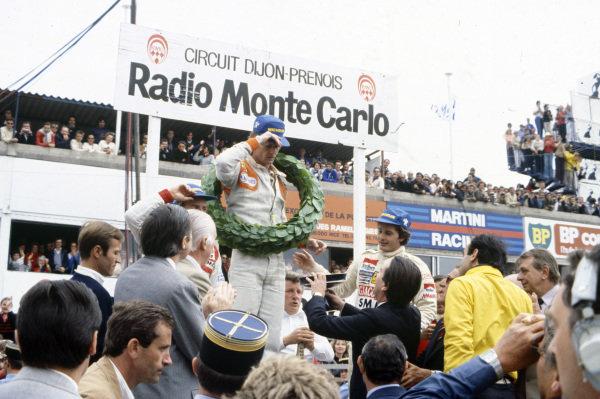 Jean-Pierre Jabouille celebrates victory with Gilles Villeneuve, 2nd position, and René Arnoux, 3rd position.