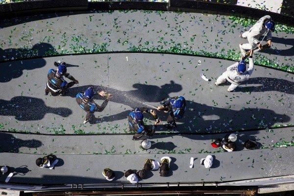 #10 Konica Minolta Cadillac DPi-V.R. Cadillac DPi, DPi: Renger Van Der Zande, Ryan Briscoe, Scott Dixon, Kamui Kobayashi, #77 Mazda Team Joest Mazda DPi, DPi: Oliver Jarvis, Tristan Nunez, Olivier Pla, and #5 Mustang Sampling Racing / JDC-Miller MotorSports Cadillac DPi, DPi: Sebastien Bourdais, Loic Duval, Joao Barbosa celebrate
