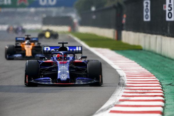 Daniil Kvyat, Toro Rosso STR14, leads Carlos Sainz Jr., McLaren MCL34