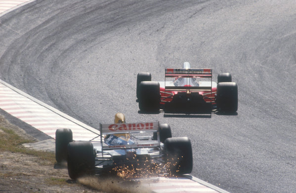 1991 Japanese Grand Prix.Suzuka, Japan.18-20 October 1991.Nigel Mansell (Williams FW14 Renault) retires from the race as he runs over the kerb and spins off at First Curve. He had been right behind Senna into First Curve, when he lost downforce, sending him wide and into the gravel. His brakes had also given him a problem most of the weekend. Ayrton Senna (McLaren MP4/6 Honda) continued to take 2nd position.Ref-91 JAP 12.World Copyright - LAT Photographic