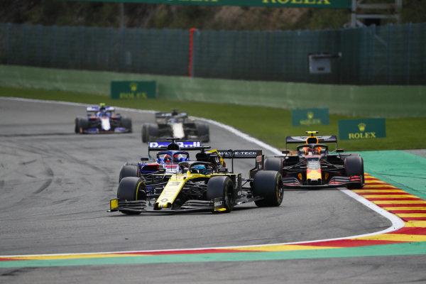 Daniel Ricciardo, Renault R.S.19, leads Daniil Kvyat, Toro Rosso STR14, Alexander Albon, Red Bull RB15, and Romain Grosjean, Haas VF-19