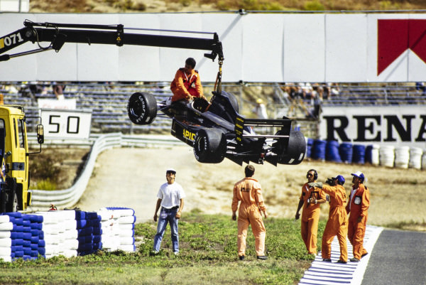 Gabriele Tarquini's AGS JH25 Ford is recovered by crane.