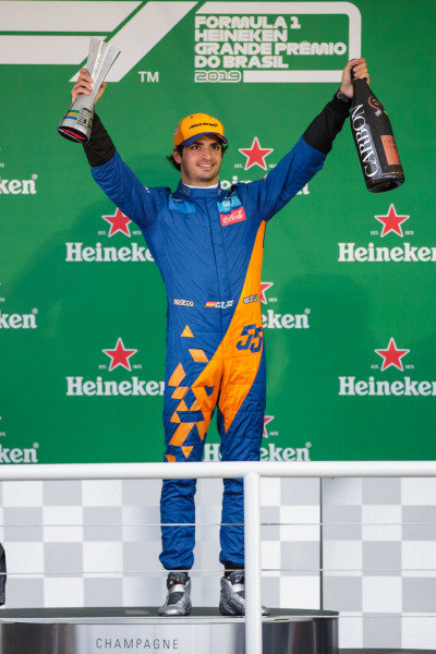 Carlos Sainz Jr, McLaren celebrates his third position on the podium with the trophy