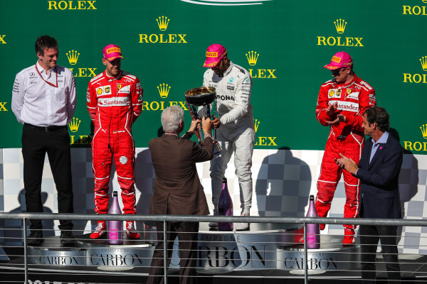 Race winner Lewis Hamilton (GBR) Mercedes AMG F1 celebrates on the podium with Bill Clinton (USA) and the trophy alongside Sebastian Vettel (GER) Ferrari, James Allison (GBR) Mercedes Technical Director and Kimi Raikkonen (FIN) Ferrari at Formula One World Championship, Rd17, United States Grand Prix, Race, Circuit of the Americas, Austin, Texas, USA, Sunday 22 October 2017.