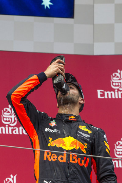 Daniel Ricciardo (AUS) Red Bull Racing celebrates with a shoey on the podium at Formula One World Championship, Rd9, Austrian Grand Prix, Race, Spielberg, Austria, Sunday 9 July 2017.
