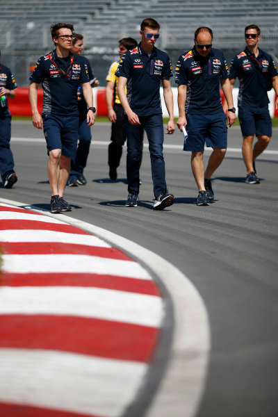 Circuit Gilles Villeneuve, Montreal, Canada. Thursday 4 June 2015 Daniil Kvyat, Red Bull Racing walks the track with his team. World Copyright: Andy Hone/LAT Photographic. ref: Digital Image _ONZ1365