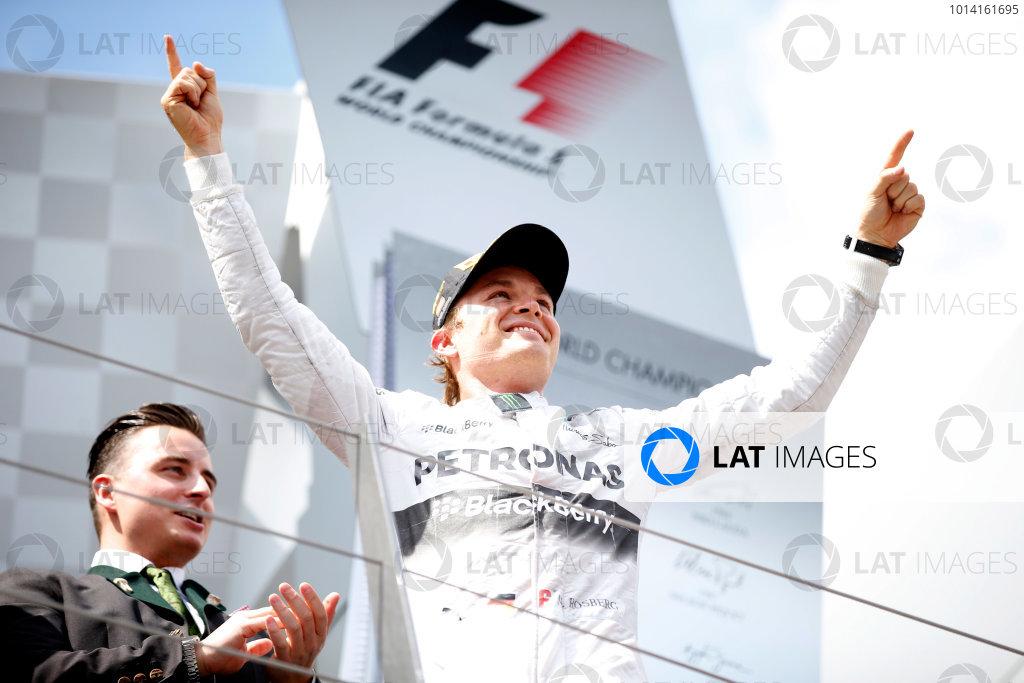 Red Bull Ring, Spielberg, Austria. Sunday 22 June 2014. Nico Rosberg, Mercedes AMG, 1st Position, on the podium. World Copyright: Glenn Dunbar/LAT Photographic. ref: Digital Image _W2Q2138