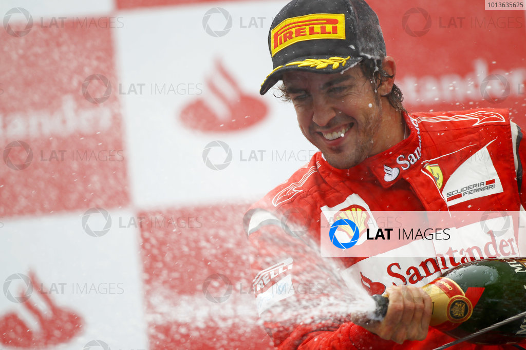 Nurburgring, Germany.24th July 2011Fernando Alonso, Ferrari 150° Italia, 2nd position, sprays the Champagne. Portrait. Podium. World Copyright: Andy Hone/LAT Photographicref: Digital Image CSP13494