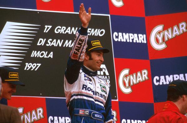 Imola, San Marino.25-27 APRIL 1997.Heinz-Harald Frentzen (Williams FW19 Renault) celebrates taking his maiden F1 win on the podium.Ref-97 SM 07.World  Copyright - LAT Photographic
